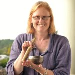 Pamela playing small brass singing bowl